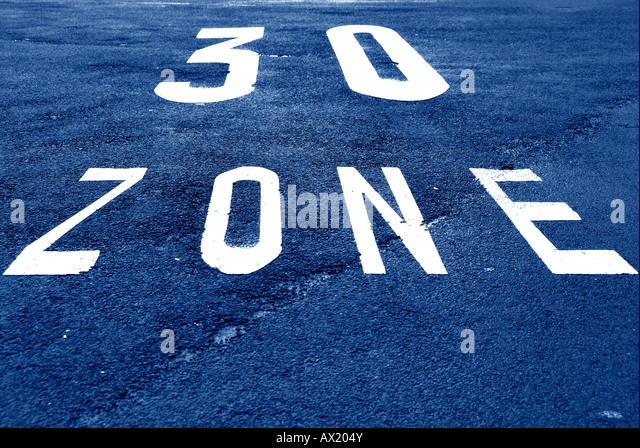 30 km/h zone marked on a road lane - Stock Image