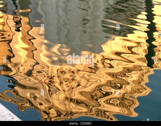 Golden Reflection in the Water - Stock Image