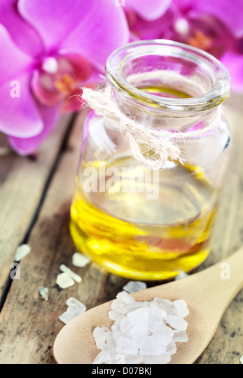 Spa Settings (essential oill, sea salt and orchid) - Stock Image