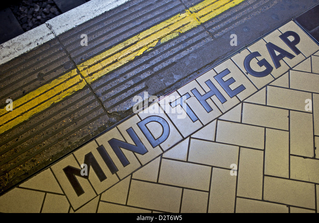 MIND THE GAP sign on platform edge, London Underground, London, England, United Kingdom, Europe - Stock Image