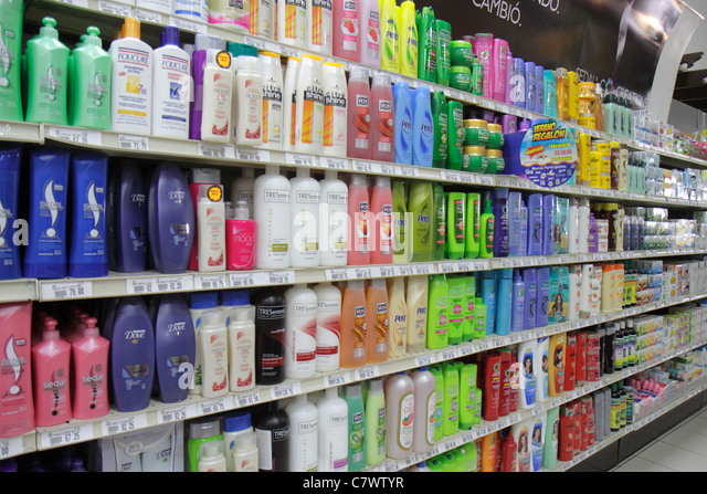 Managua Nicaragua Plaza Espana La Colonia Supermarket grocery store shopping shelves shelf competing products for - Stock Image