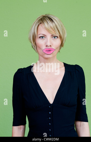 Woman wearing fake lips - Stock Image