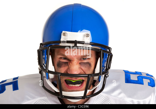 Photo of an American football player, cut out on a white background. - Stock Image