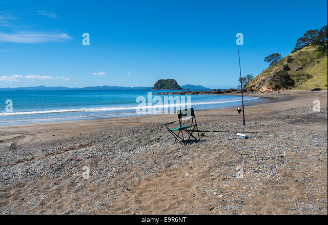 Sandy shore and rocks, Port Jackson, Coromandel Peninsular, New Zealand - Stock Image