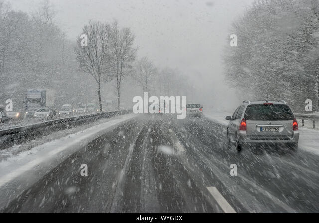 Cars with falling snow and ice, motorway A7, poor visibility, Bavaria, Germany - Stock Image