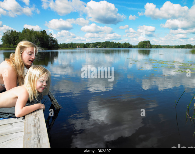 Woman and girl on a dock - Stock Image