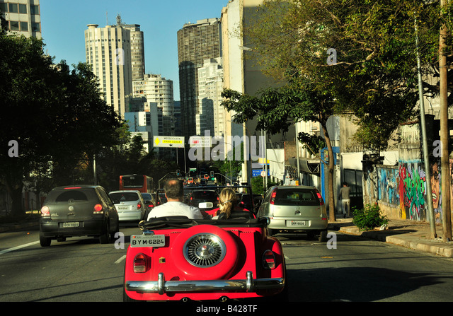 Red car at Consolacao Avenue downtown Sao Paulo Brazil - Stock Image