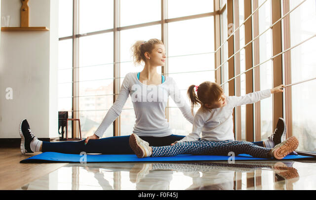 Mother and daughter shows something in the window - Stock Image