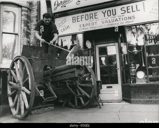 Feb. 02, 1967 - Antique German Field Gun for Sale : Standing on the forscourt outside the shop of antique dealer, - Stock Image