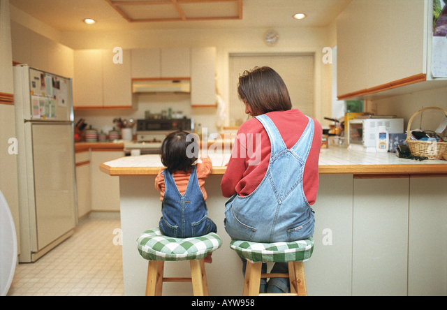 Mother and a little girl in the kitchen - Stock-Bilder