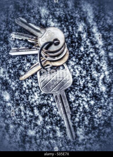Keys on granite surface - Stock Image