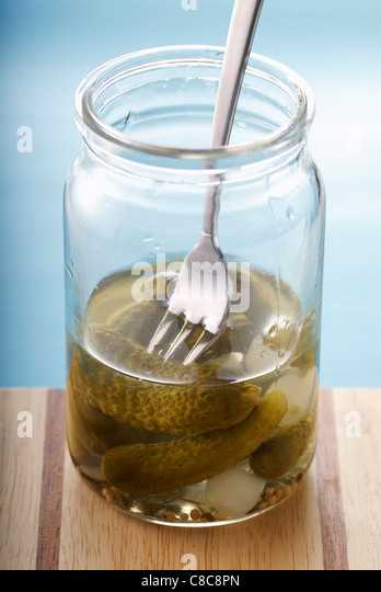 jar of gherkins half empty - Stock Image