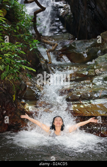 Woman Waterfall Bathing Stock Photos & Woman Waterfall ...