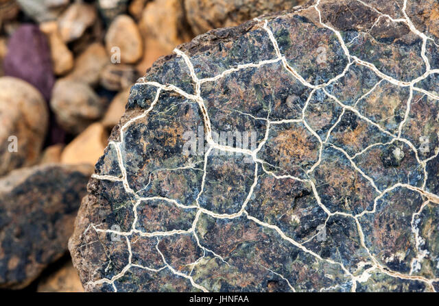 Close-up of serpentine Peridotite rocks in the Tablelands, Gros Morne National Park, near Woody Point, Newfoundland, - Stock Image