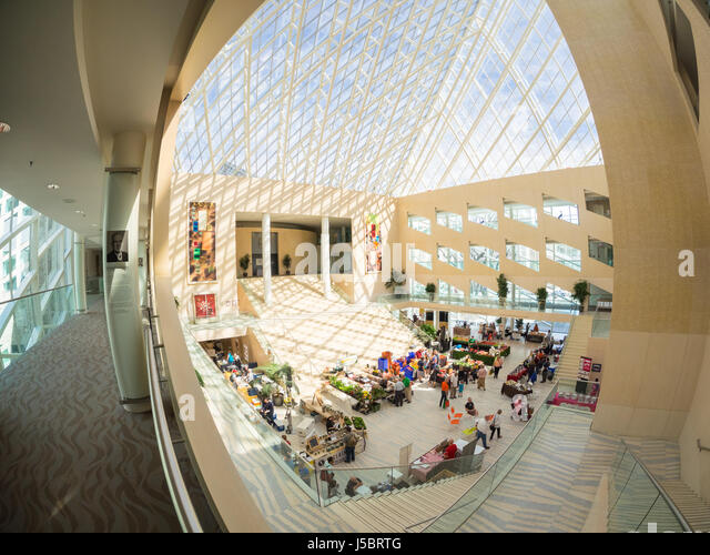 A wide angle, fish-eye view of the City Market (City Farmers' Market) and atrium interior of Edmonton City Hall - Stock Image