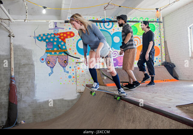 Group of young adults at skating rink. - Stock Image