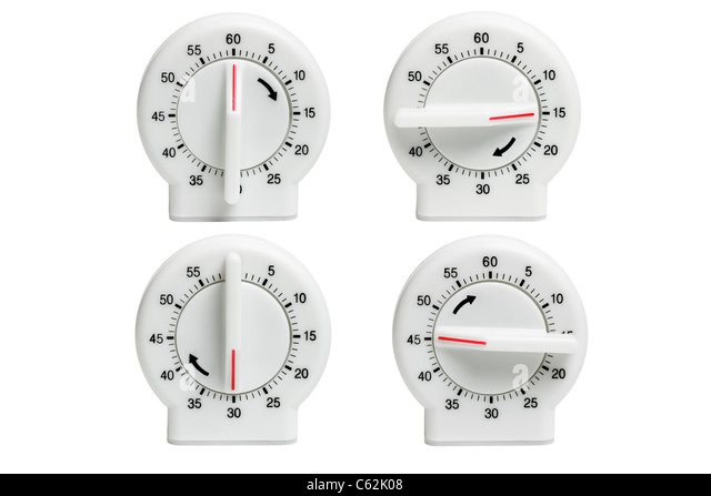 Collection of Kitchen timers showing dial setting at different times on white background - Stock Image