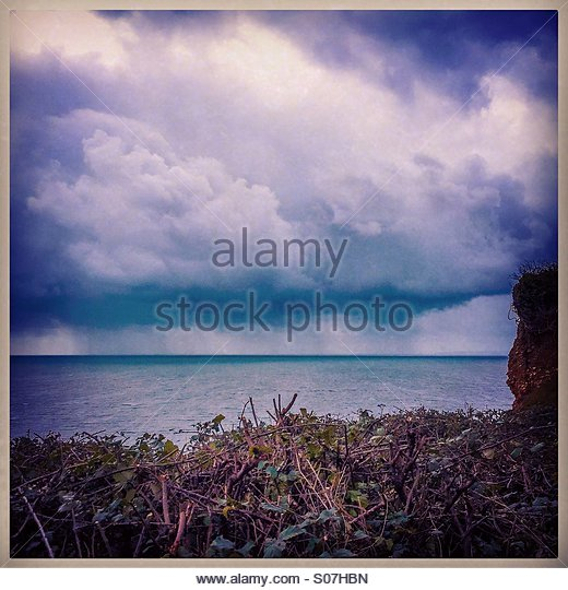 Storm clouds about to hit the south coast of Devon, UK - Stock Image
