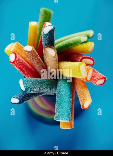 Stack of coloured gummy sweet sticks - Stock Image