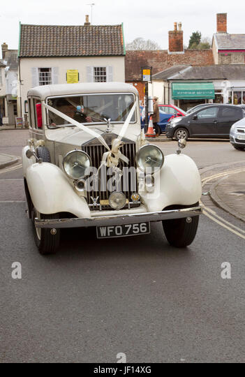 Vintage Rolls Royce white ribbon deco - Stock Image