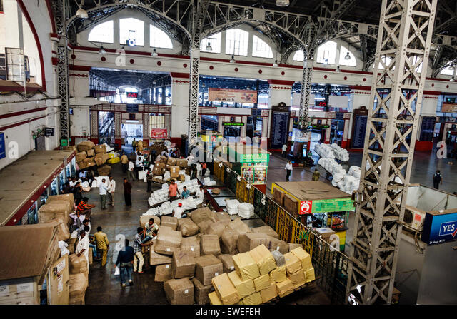 India Indian Asian Mumbai Mumbai Central Railway Station train Western Line public transportation laundry carts - Stock Image