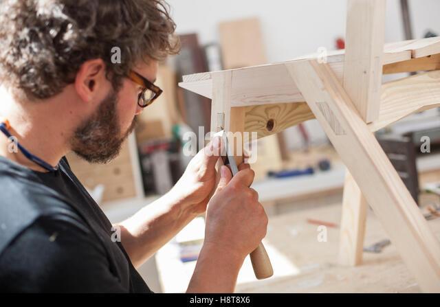 Furniture designer maker working in his workshop - Stock-Bilder