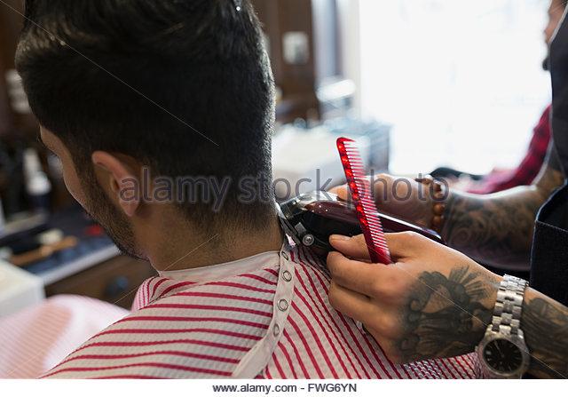 Barber shaving man - Stock-Bilder