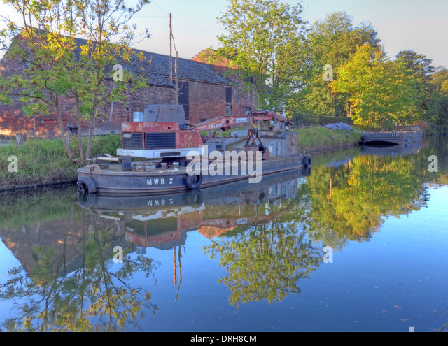 MWB2 riveted steel crane barge at work on the Bridgewater Canal, near Grappenhall, Cheshire,UK - Stock Image