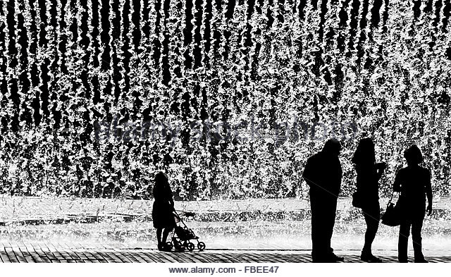 Silhouette People Looking At Waterfall - Stock Image