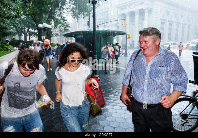 Manhattan New York City NYC NY Midtown Union Square pedestrian plaza busy street sudden rain running taking cover - Stock Image