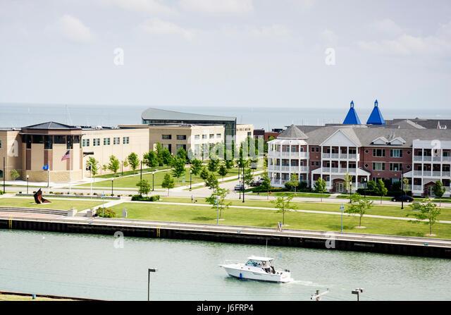 Wisconsin Kenosha view from Southport Lighthouse HarborPark park promenade multi-family housing condominium boat - Stock Image