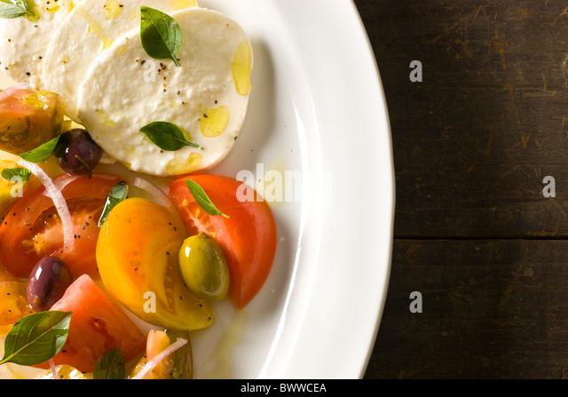 Mozzarella with Tomato and Olive variety, Olive Oil and Fresh Oregano - Stock-Bilder
