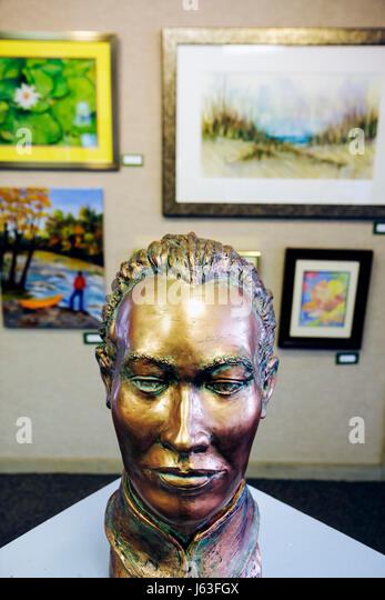 Indiana Chesterton Chesterton Art Center visual art local artists bronze head sculpture framed paintings exhibit - Stock Image