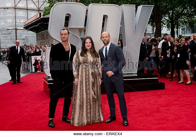 epa04771204 From (L-R) Actors/cast members British Jude Law, British Jason Statham and US Melissa McCarthy pose - Stock Image