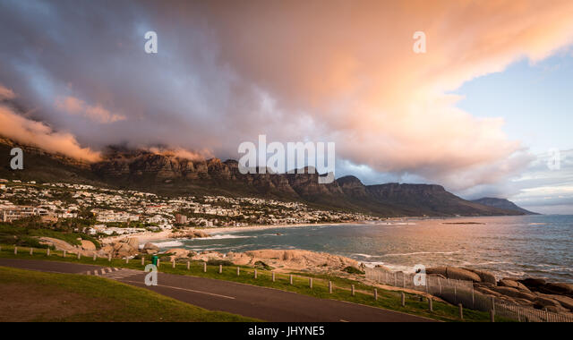 Sunset and clouds over Camps Bay, Table Mountain and the Twelve Apostles, Cape Town, South Africa, Africa - Stock Image