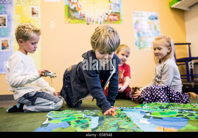 Elementary students playing in kindergarten - Stock Image
