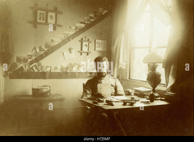 Soldier sitting at a desk, Italy - Stock Image