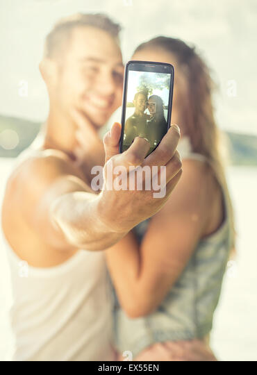 Couple in love on the lake, close-up, selfie - Stock Image