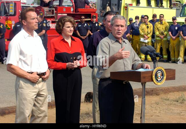 California Governor Arnold Schwarzenegger and California Senator Dianne Feinstein look on as U.S. President George - Stock Image