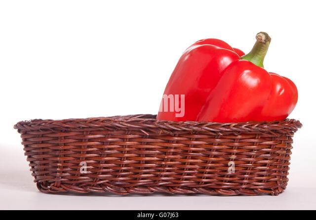 red pepper inside little basket isolated on white - Stock Image