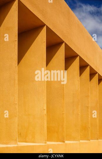Sunlit facade perspective. Laayoune Technology School, Laayoune, Morocco. Architect: Saad El Kabbaj, Driss Kettani, - Stock-Bilder