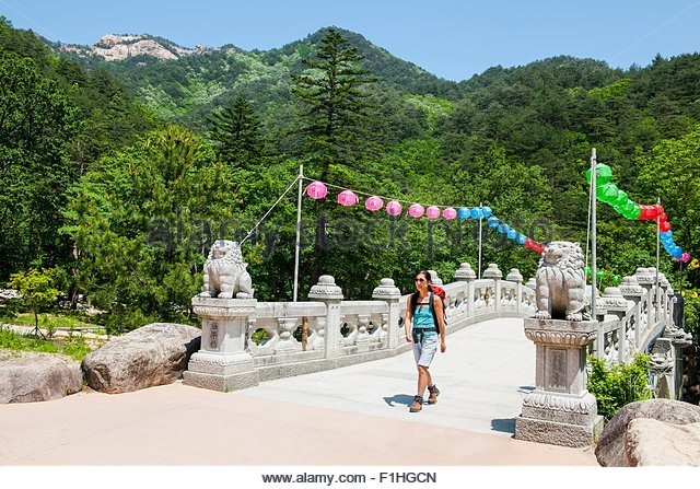 Woman hiking over a stone bridge on the way to Mt. Ulsanbawi at Seoraksan national park, Gangwon, South Korea - Stock Image