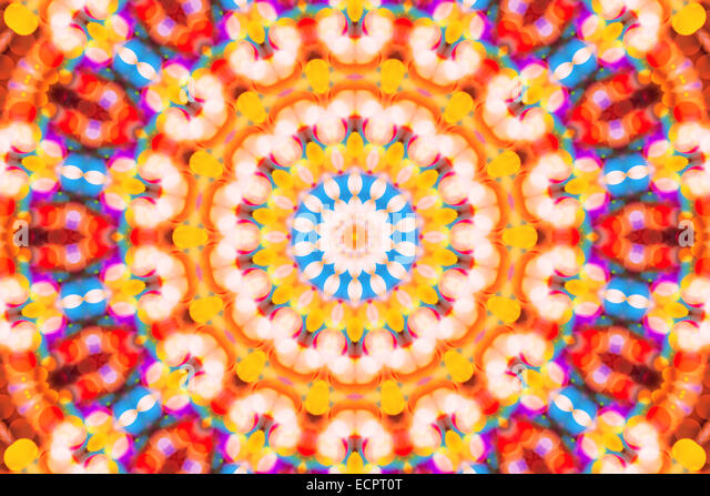Beautiful colorful defocused bokeh festive lights in kaleidoscope as abstract holiday celebration background - Stock Image
