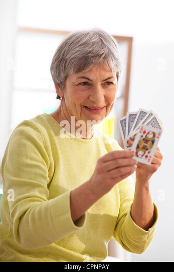 ELDERLY P. PLAYING A GAME - Stock Image