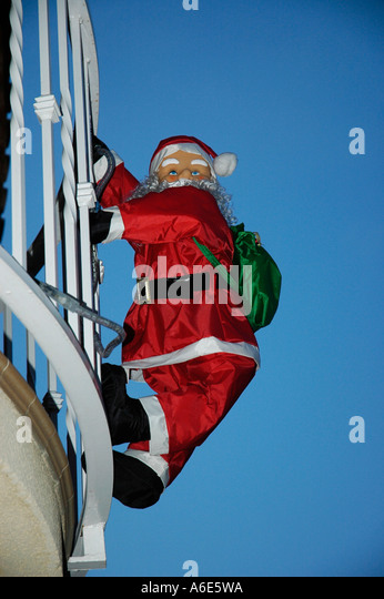 Santa Claus Climbing Christmas Decoration Stock Photos