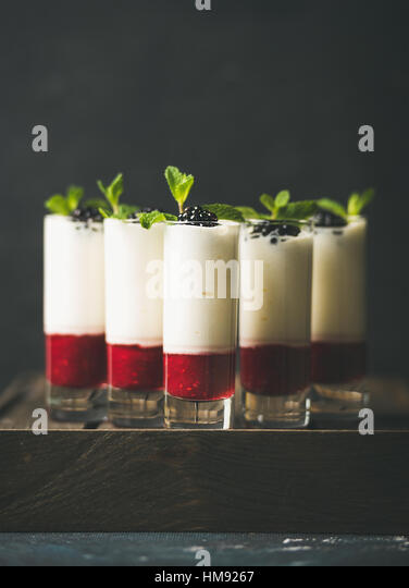 Dessert in glass with blackberries and mint, copy space - Stock Image