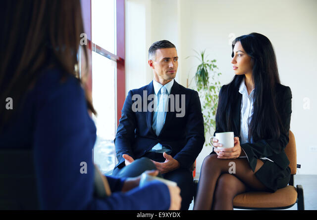 Business people having meeting in office - Stock Image