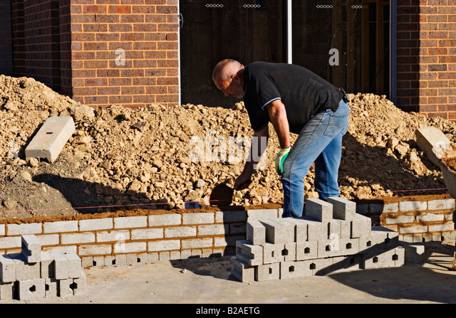 Building industry residential construction a bricklayer at work on a