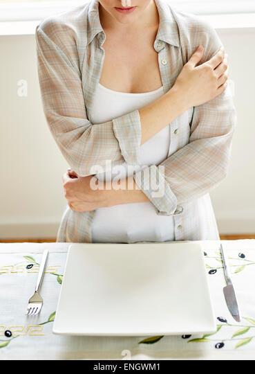 Woman refusing food - Stock Image