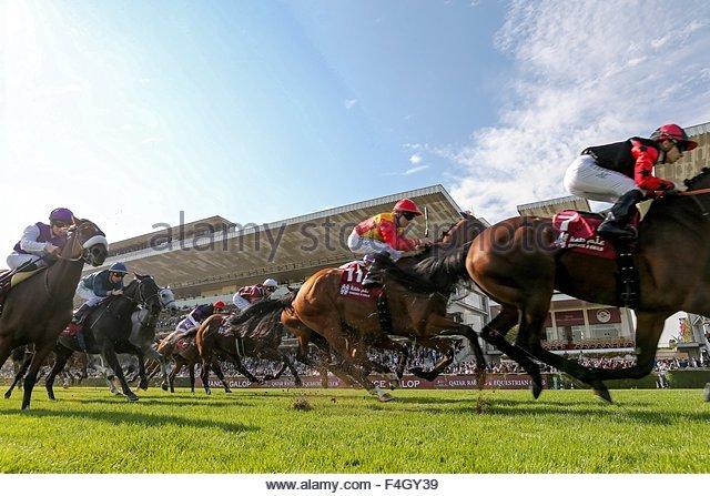 Paris, France. October 3rd, 2015. FRANCE, Paris: Jockeys get on horses for Qatar Grand Handicap des Milers during - Stock Image